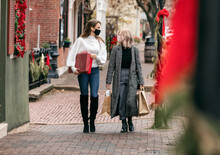 Christmas: Female Friends Holiday Shop During Covid