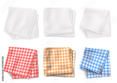 Leinwand Poster Gingham tablecloths and white kitchen towels top view