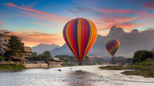 Nam Song River At Sunset With Hot Air Balloon In Vang Vieng, Laos, Beautifull Landscape On The Nam Song River In Vang Vieng, Laos.