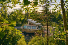 Old  Pop Up Camper Van Off The Road Camping On A Forest.