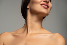 Mouth, Neck And Bare Shoulders Of A Smiling Woman