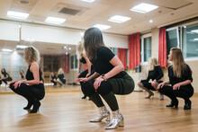 Group Of Women Doing A High Heels Dance Class