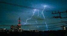 Electric Wires During Thunderstorm In City In Japan