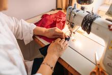A Woman Sews