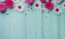 Green Wooden Background With Colorful Flowers