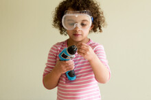 Cute Girl In Safety Glasses With Small Driver