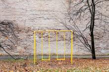 Old Abandoned Swing Set In Empty Yard