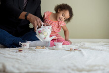 Dad Pours Hot Chocolate For Daughter