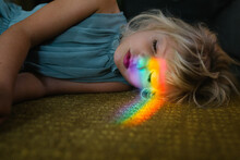 Portrait Of A Girl With The  Light Of Rainbow On Her Face