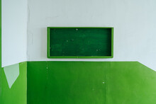 Green Notice Board On A Green Wall