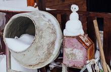 Snowman And Rustic Stuff In Yard