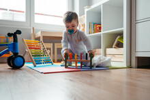 Cute Toddler Playing With Toys At Home