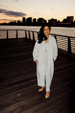 Woman In All White By The Skyline