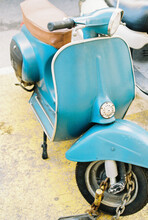Blue Vintage Scooter Parked In The Street.