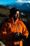 Traveling photographer enjoying nature in mountains