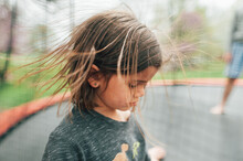 Girl With Crazy Hair Playing Outside.