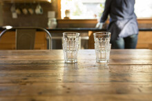 Clean Stacked Glasses On Wooden Table