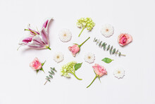 Flowers Assembled On Pale Pink Background