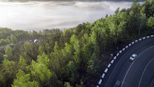 Fog Over The River, Forest And The Edge Of The Asphalt Road On The Hill, Beautiful View Of The Travel Landscape