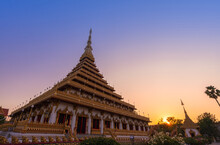 Golden Ancient Pagoda Of Phra Mahathat Kaen Nakhon (Wat Nong Wang) Temple With Twilight Sunset Sky, Thai Traditional Religious History Travel Attraction In Khon Kaen, Thailand