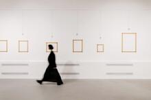 Defocused Woman Walking In Exhibition Art Hall