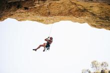 Adventurer Man Wearing Safety Harness Climbing Mountain