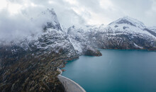 Panorama Of Water Dam In Alps Mountains, Aerial View
