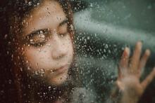 Girl And Wet Window