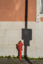 Urban Architecture With A Red Element And A Hard Shadow