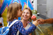 Portrait Of A Mother With A Child Buying Ice Cream