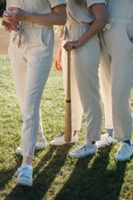 Young Women's Legs Standing In Formation On A Baseball Field