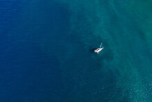 Lonely Sailboat On Caribbean Sea Coast In Martinique Island, France, View From Above