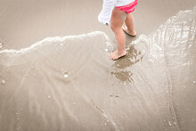 Barefoot Child At Ocean Edge