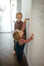 Young Toddler Trying To Open The Door, Big Brother Watching