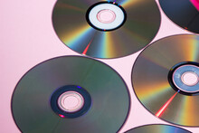 Compact Discs On A Pink Background. Technologies Of The Past. Retro Background