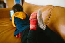 Childs Feet With Mismatched Socks