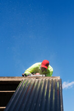 Tradie Working On A Roof