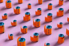 Orange Film Rolls On Pink Background - Different Sizes