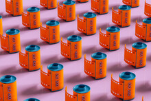 Orange Film Rolls On Pink Background