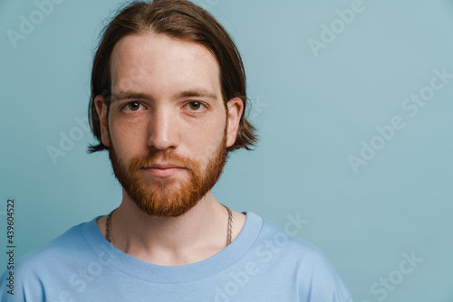 Fotografie, Obraz Young ginger man with beard posing and looking at camera