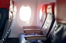 Aircraft Cabin With Empty Passenger Rows Of Seats.