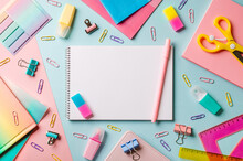 Creative Student Desk With White Sheet Of Notebook Paper And School Supplies. Top View With Copy Space. Back To School Flat Lay On Blue And Pink Background