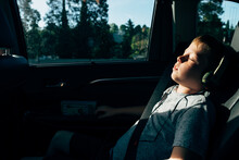 Boy Listening To Music On Road Trip