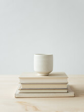 Minimal Table Scene With Stack Of Books