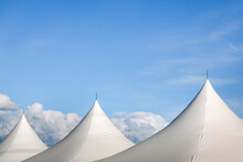 White Tents With Blue Background