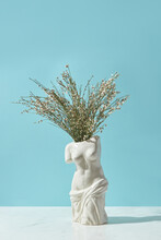 Vase In Shape Of Venus De Milo With Twigs
