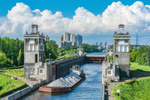 Freight Ship Moves Through The Gateway Of The River. Moscow.