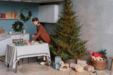 Young female preparing for Christmas celebration in loft