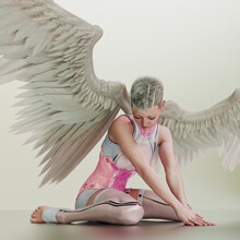 Futuristic Scfi Angel On Ground With Feather Wings