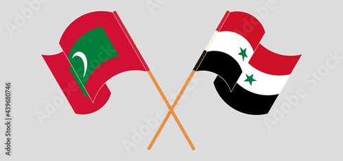 Fotografia Crossed and waving flags of Maldives and Syria